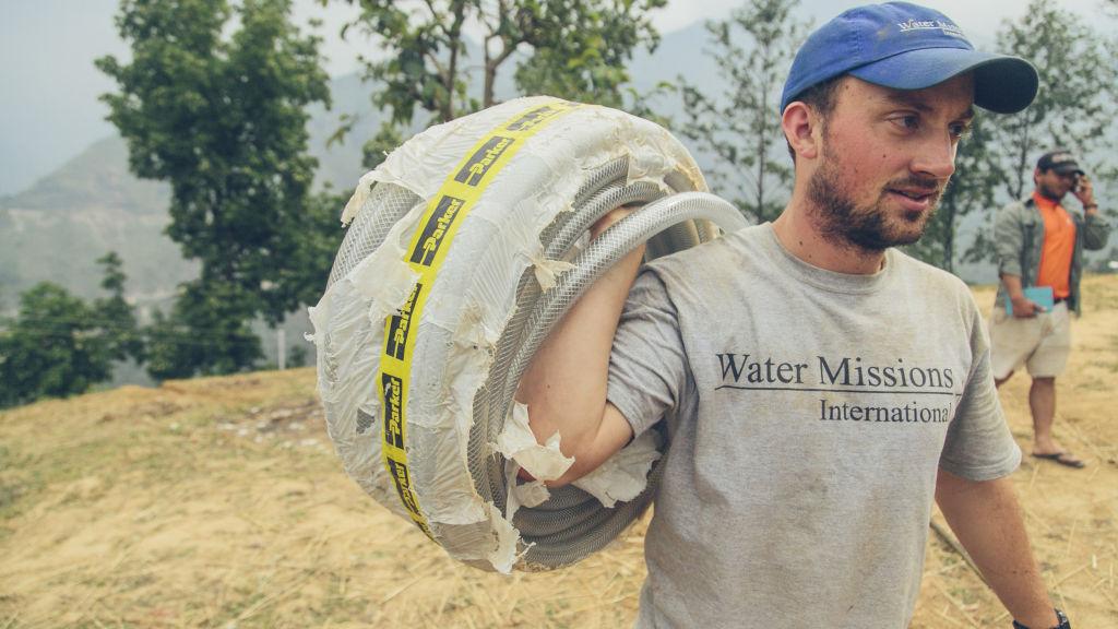 Tim carries Parker hose | Nepal Earthquake