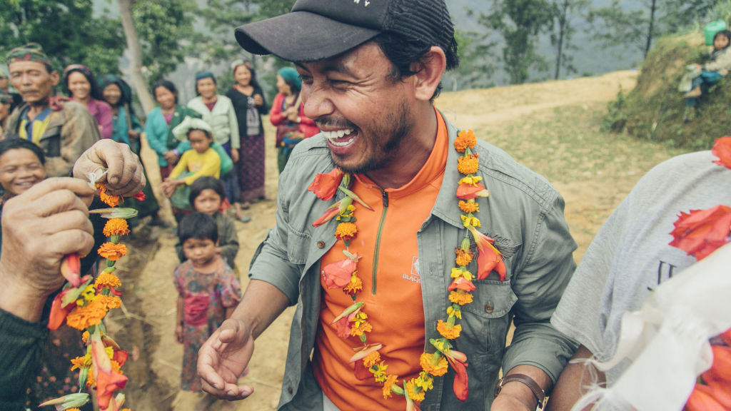 Receiving flower necklaces | Nepal Earthquake