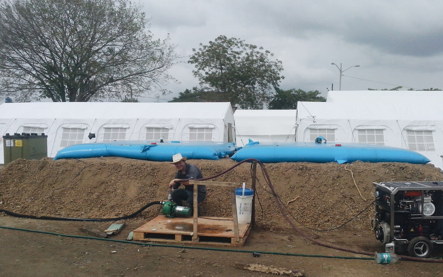 Water Mission engineer Bert Morrison with water equipment at Ecuador field hospital