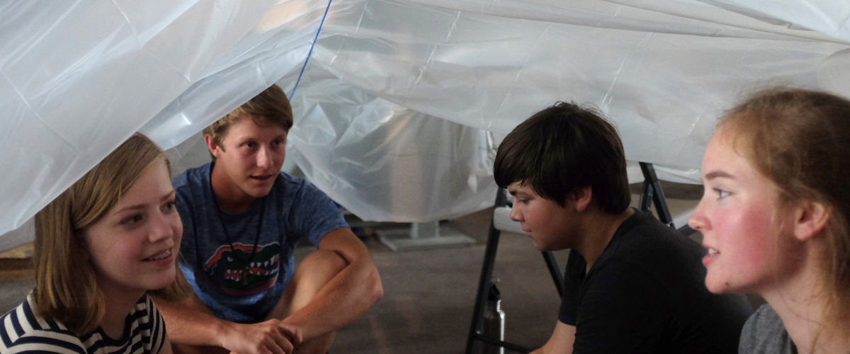 A youth group builds a temporary shelter as a part of Project Disaster.