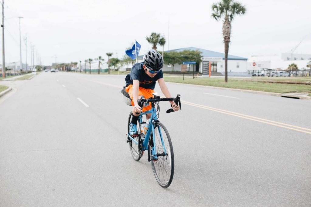 Scotty Parker rides his bike to raise money for safe water with Water Mission.