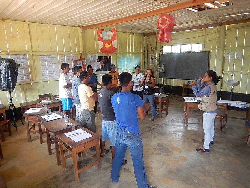 Water Mission Peru staff conduct a WASH training course with the safe water committee.