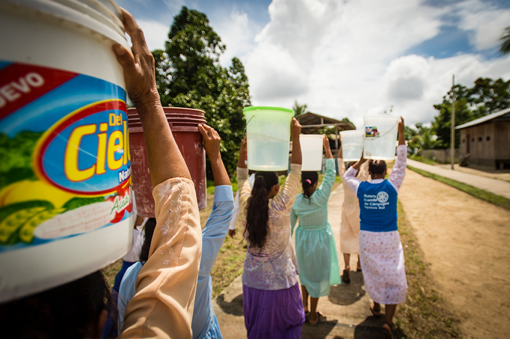 People collect safe water at a project in Peru.