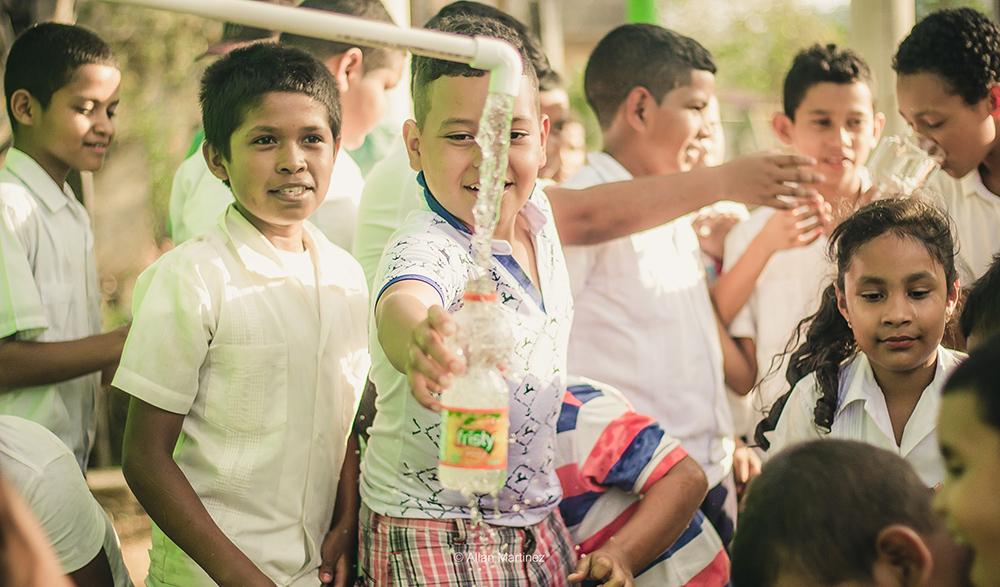 A young boy enjoys safe water!