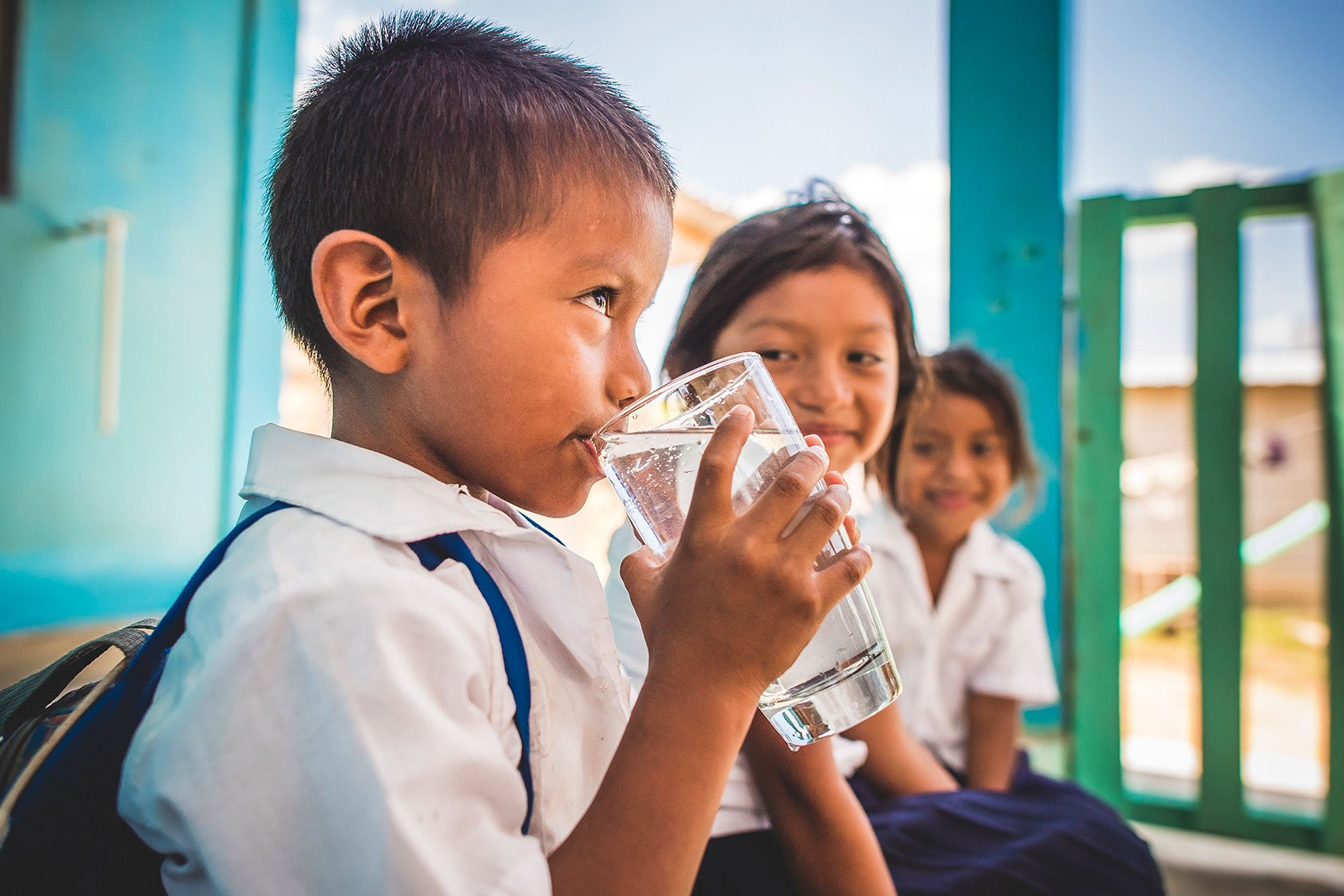 A young boy enjoys safe water in Honduras thanks to Pentair and Water Mission.