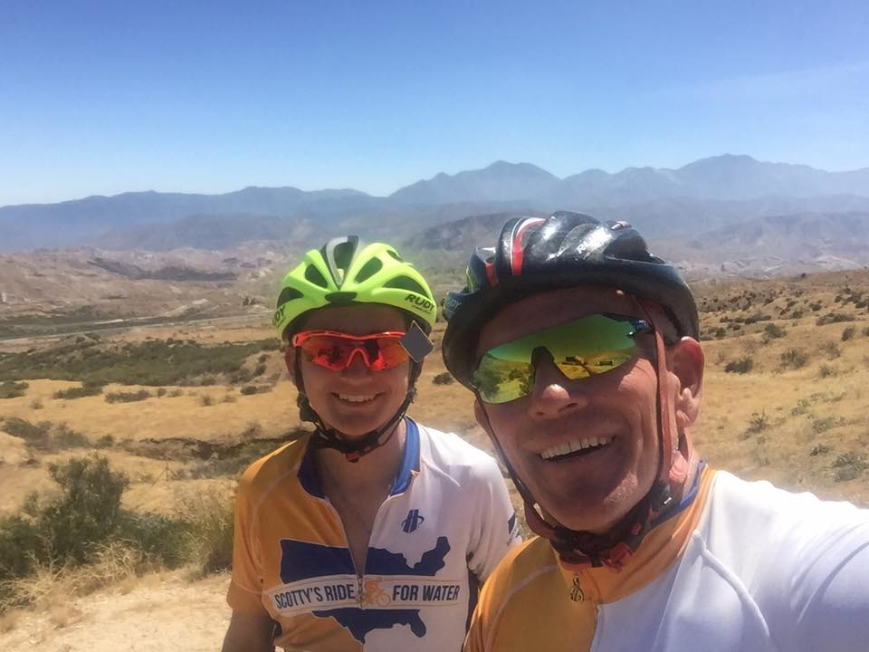 Scotty and a teammate take a selfie while biking through the mountains.