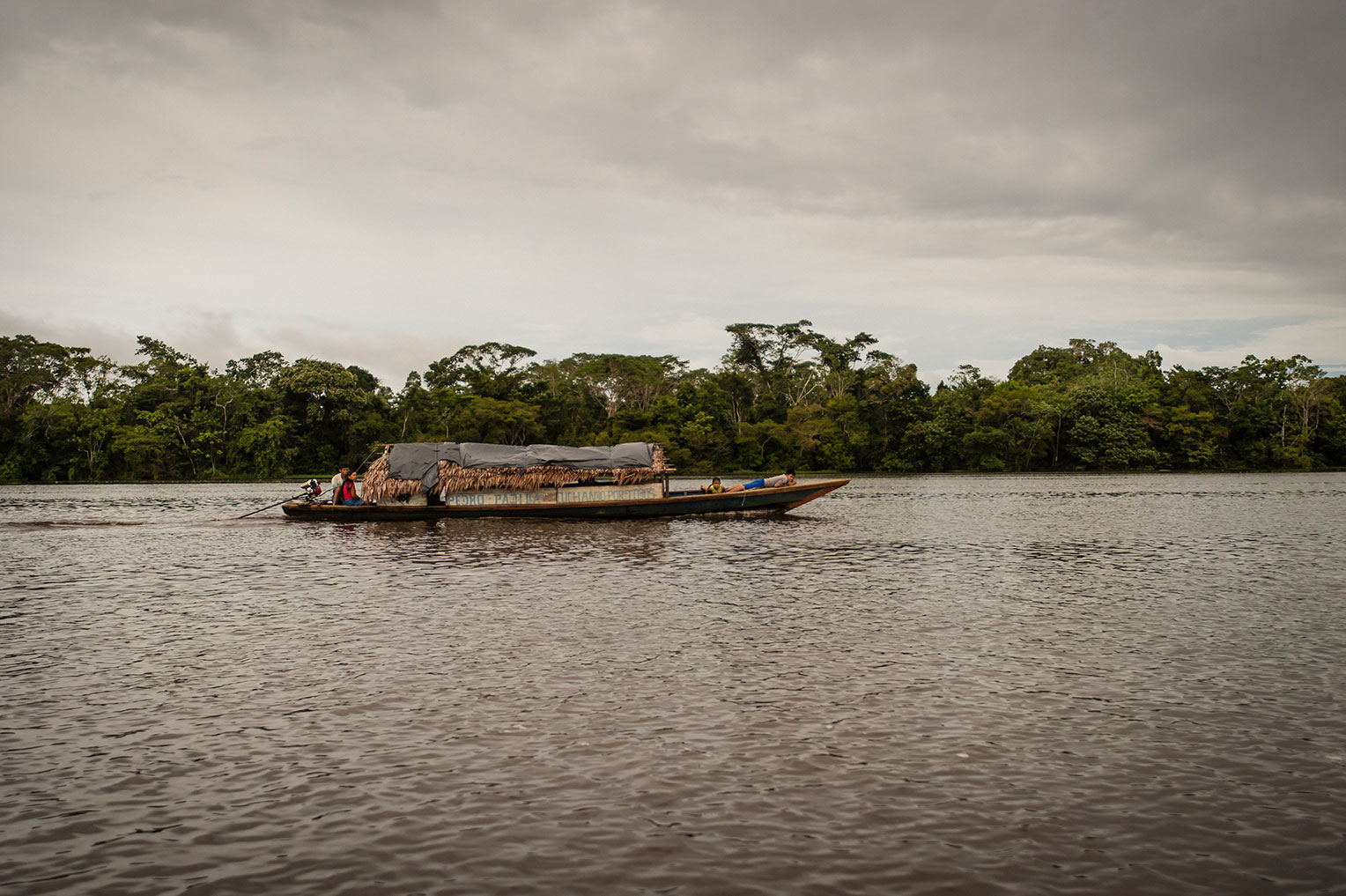 A boat travels up the Amazon river.
