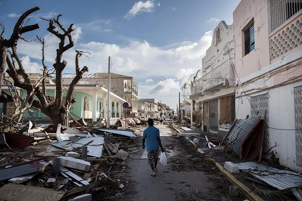 A survivor walks down a street on St. Martin following Hurricane Irma.