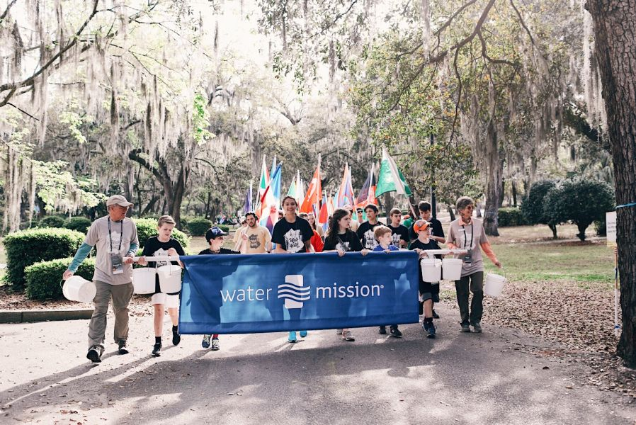 Water Mission's co-founders, George and Molly Greene walk with supporters to bring safe water to those in need around the world.
