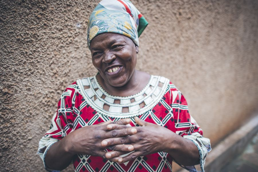 Jaina Iddi Mwenda, 58, Community Health Officer for the government and WASH Coordinator for Water Mission in and around her home. Taken by Sean Sheridan, for Water Mission.