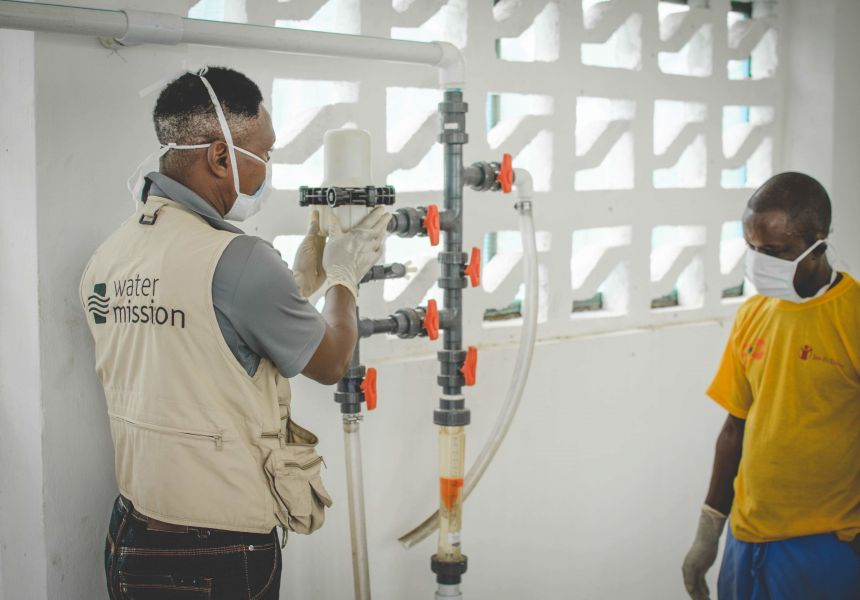 installing safe water treatment for a hospital in Liberia during the Ebola outbreak.